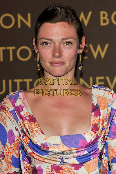 CAMILLA RUTHERFORD .attends the launch of the Louis Vuitton Bond Street Maison Store in London, England, UK, May 25th, 2010. .portrait headshot hair up dangly earrings gold purple cream orange print pink .CAP/PL.©Phil Loftus/Capital Pictures.