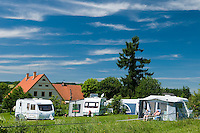 Vernerovice, Giant Mountains, Northern Bohemia, Czech Republic, June 2010. Dutch run Camping Aktief in Vernerovice. The area around Teplice, also known as the Broumovsky Steny, was inhabited by ethnic Sudeten Germans, that were deported after the Second World War. The rural landscape with green fields and cattle is dotted with little villages scarred by communist socialist architecture. Photo by Frits Meyst/Adventure4ever.com