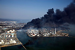 March 13, 2011, Sendai, Japan - Columns of thick black smoke reach high in the air from a burning oil refinery in Sendai, Miyagi prefecture, on Sunday, March 13, 2011, two days after a powerful earthquake with a magnitude 9.0 jolted Japan's northeastern prefectures, wreaking havoc on otherwise beautiful coastal towns and farmlands. The death toll from the nation's worst and the world's fourth worst quake could rise above 10,000. (Photo by Yoichi Tsukioka/AFLO) [2570] -mis-