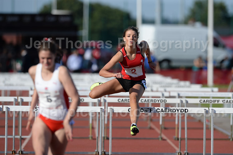 International athletics at Cardiff International stadium, Cardiff, South Wales - Tuesday 15th July 2014<br /> <br /> Claire Taylor of Wales U20 (2) competes in the Women's 100m hurdles final <br /> <br /> <br /> Photo by Jeff Thomas Photography