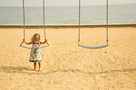 Surf Club Town Beach Park. Toddler in swing.