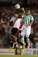 BUENOS AIRES - ARGENTINA - 10-12-2014: Leonardo Ponzio (Izq.) jugador de River Plate de Argentina disputa el balon con Orlando Berrio (Der.) jugador de Atletico Nacional de Colombia durante partido de vuelta de la final, de la Copa Total Suramericana entre River Plate de Argentina y Atletico Nacional de Colombia en el Estadio Antonio Vespucio Liberti- Monumental de Nuñez, de la ciudad de Buenos Aires.  / Leonardo Ponzio (L) player of River Plate of Argentina vies for the ball with con Orlando Berrio (R) player Atletico Nacional of Colombia during a match for the second leg of the final, between River Plate of Argentina and Atletico Nacional for the Copa Total Suramericana in the Antonio Vespucio Liberti- Monumental de Nuñez, Stadium, in Buenos Aires city. Photo:  Photogamma / VizzorImage.