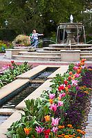 Bike riders by fountain in Norfolk Botanical Garden