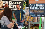 Candid activity at the Our Daily Bread booth, at the Saugerties Farmer's Market on Main Street in the Village of Saugerties, NY, on Saturday, June 10, 2017. Photo by Jim Peppler. Copyright/Jim Peppler-2017.