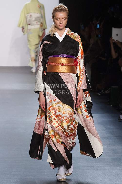 "Model walks runway in a ""Changing colors"" silk kimono from the Hiromi Asai Fall Winter 2016 ""Spirit of the Earth"" collection by Hiromi Asai & Kimono Artisan Kyoto, presented at NYFW: The Shows Fall 2016, during New York Fashion Week Fall 2016."