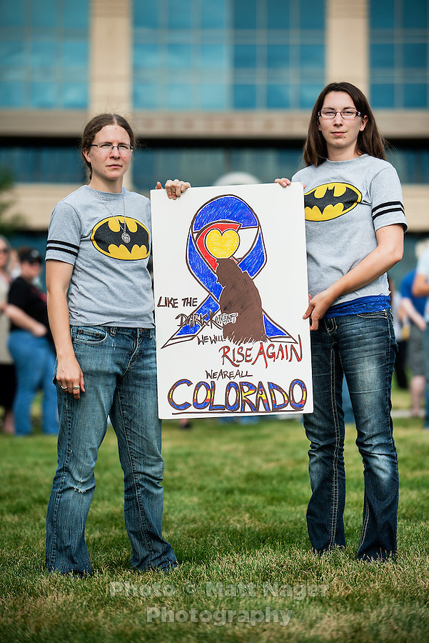 Kronda Seibert (cq, left), 24, and Jamie McCurdy (cq, 25) both from Aurora, stand with a poster they made in support of the 12 victims of the mass shooting at the Aurora Century 16 movie theater during a prayer vigil at the Aurora Municipal Center, in Aurora, Colorado, Sunday, July 22, 2012. Suspect James Holmes, allegedly went on a shooting spree and killed 12 people and injured 59 during an early morning screening of 'The Dark Knight Rises.'..Photo by MATT NAGER