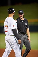 Umpire Paul Clemons talks to first base coach Jason Esposito (31) during an Arizona Fall League game between the Scottsdale Scorpions and Mesa Solar Sox on September 18, 2019 at Sloan Park in Mesa, Arizona. Scottsdale defeated Mesa 5-4. (Zachary Lucy/Four Seam Images)