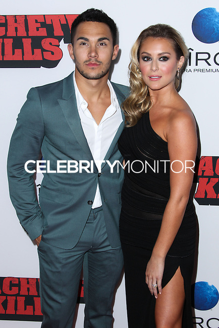 """LOS ANGELES, CA - OCTOBER 02: Alexa Vega and her fiance Carlos Pena, Jr arrive at the Premiere Of Open Road Films' """"Machete Kills"""" held at Regal Cinemas L.A. Live on October 2, 2013 in Los Angeles, California. (Photo by Xavier Collin/Celebrity Monitor)"""