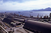 Paranagua Port, Parana State, Brazil. Overview of port with dockside warehouses and cranes.