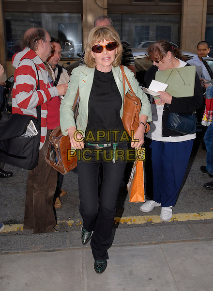 BRIT EKLAND.Arriving at Radio 2,.London, England, 15th October 2007..full length black trousers green jacket brown bag sunglasses autograph hunters fans.CAP/IA.©Ian Allis/Capital Pictures
