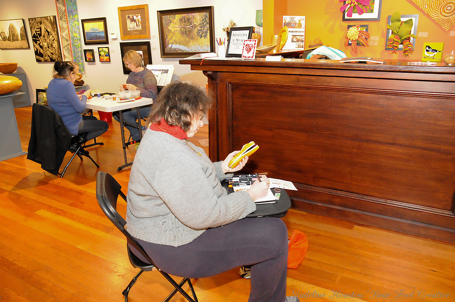 Artist Sara Light-Waller sketches at the Rectangle Gallery.<br />