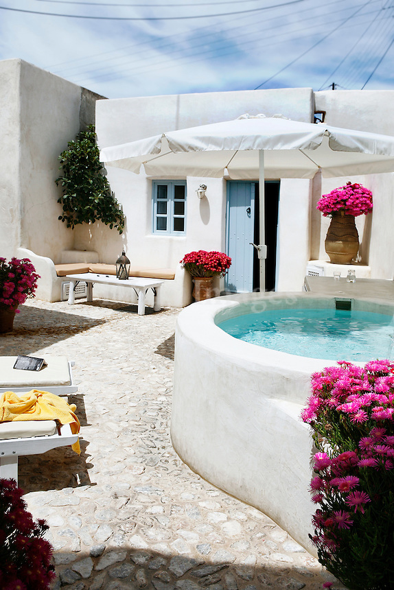 traditional stone tile patio with jacuzzi