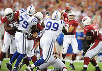 Sept. 27, 2009; Glendale, AZ, USA; Arizona Cardinals quarterback (13) Kurt Warner is pressured by the Indianapolis Colts defense at University of Phoenix Stadium. Mandatory Credit: Mark J. Rebilas-