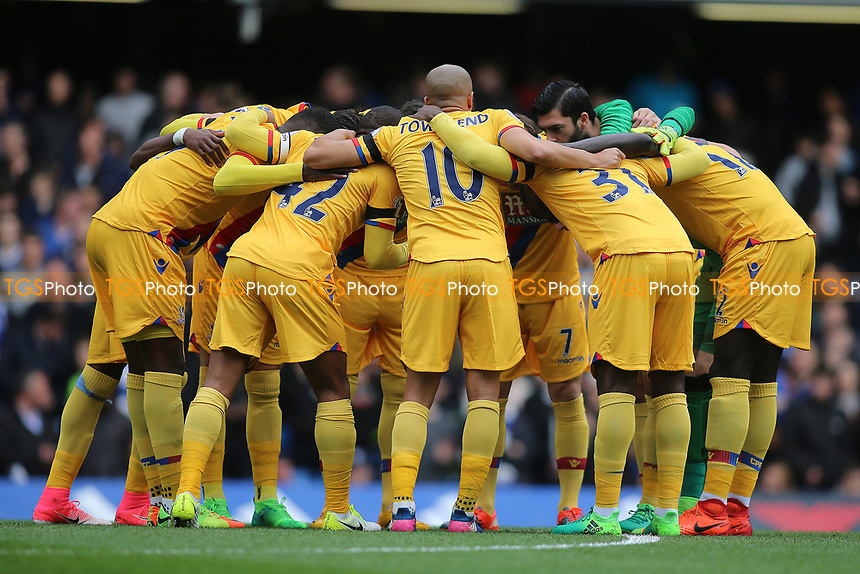Team hug by Palace before kick off during Chelsea vs Crystal Palace, Premier League Football at Stamford Bridge on 1st April 2017