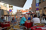People at tables outside bar Katwijk, Holland