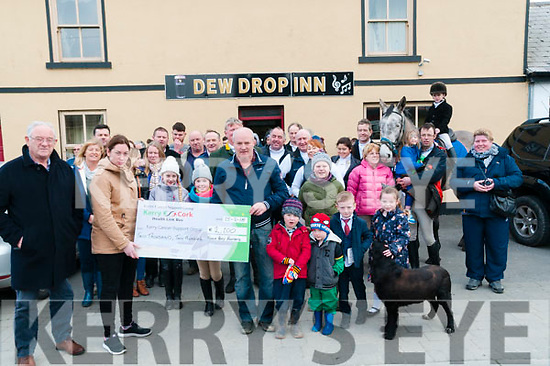 Cheque Presentation : Jeremiah o'Connor of the North Kerry Harriers presenting a cheque for €2200.00 to Trish Kiely of the Kerry Cancer Support Group ptior to the start of the North Kerry Harriers hunt on Sunday last at the dew Drop Inn, Lixnaw.