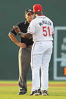 Manager Billy McMillon (51) of the Greenville Drive argues a call with umpire Jose Esteras during a game against the Lakewood BlueClaws on July 12, 2011, at Fluor Field at the West End in Greenville, South Carolina. (Tom Priddy/Four Seam Images)