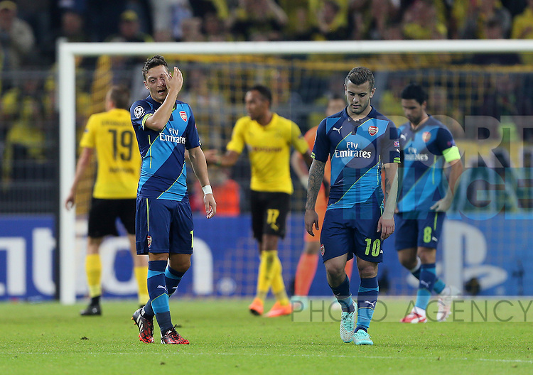Arsenal's Mesut Ozil and Jack Wilshere look on dejected after Dortmund's opening goal<br /> <br /> - Champions League Group D  - Borussia Dortmund vs Arsenal - Signal Iduna Park - Germany - 16th September 2014 - Picture David Klein/Sportimage