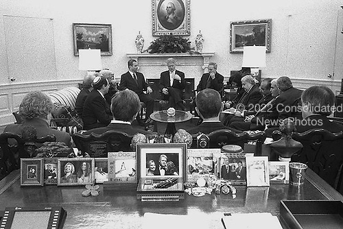 Washington, D.C. - December 15, 1999 -- United States President Bill Clinton meets with Israeli and Syrian Delegations in The Oval Office, The White House, December 15, 1999. From Left to Right: In Foreground (L to R): United States Secretary of State Madeleine Albright, National Security Advisor Sandy Berger, White House Chief of Staff John Podesta, Special Envoy Dennis Ross; Seated (L to R): Eli Rubinstein, Uri Sagui, Danny Yatom, Foreign Minister David Levy of Israel, Prime Minister Ehud Barak of Israel, THE PRESIDENT, Foreign Minister al-Sharaa of Syria,  Bouthaina Sha-ban, Ambassador Walid Moualem of Syria, Riyad Daoudi, Major General Omar..Credit: Sharon Farmer - White House via CNP