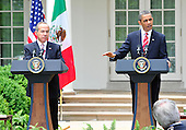 United States President Barack Obama, right, and President Felipe Calderón of Mexico, left, hold a joint press conference in the Rose Garden of the White House in Washington, D.C. during a State Visit on Wednesday, May 19, 2010..Credit: Ron Sachs / CNP