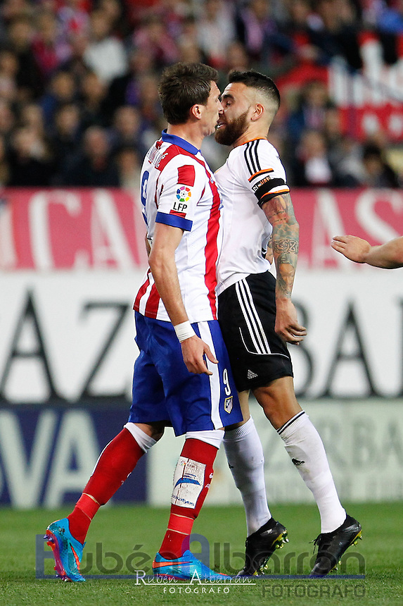 Atletico Madrid´s Croatian forward Mario Mandzukic and Valencia´s Argentinean defense Otamendi