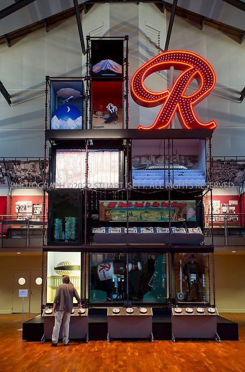 """12/27/2012--Seattle, WA, USA..The Museum of History and Industry (MOHAI) will open Dec. 29th, 2012 in the former Naval Reserve Training Center in Seattle's South Lake Union neighborhood. Here the Rainier Brewing Company's old red """"R"""" sign sits on top of displays lit up by cranking handles at the bottom...Exhibits include Boeing B-1 seaplane (Boeing's first plane), the Rainier Brewing Company's old red """"R"""" sign and Slo-Mo-Shun IV Hydroplane. MOHAI has around 4 million objects in the collection, including around 100,000 artifacts, and 1.5 million photographs, and extensive archives. Collections focus on Seattle's early settlement (ca. 1850) through present-day, and concentrate on the stories and achievements of Seattle's residents...©2012 Stuart Isett. All rights reserved."""
