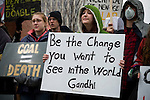 Protestors take part in the March in March outside the TVA headquarters in Knoxville, Tennessee. One protestor holds up a quote from Gandhi, 'Be the Change you want to see in the World'. The protestors were protesting coal mining during an event called Mountain Justice Spring Break on March 14, 2009.