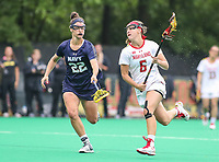 College Park, MD - May 19, 2018: Maryland Terrapins Meghan Doherty (6) runs past Navy Julia Collins (22) during the quarterfinal game between Navy and Maryland at  Field Hockey and Lacrosse Complex in College Park, MD.  (Photo by Elliott Brown/Media Images International)