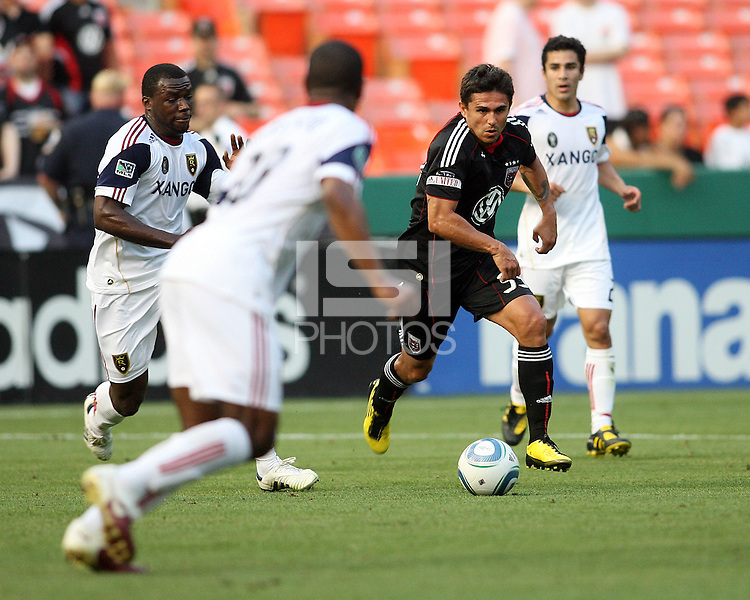 Jaime Moreno #99 of D.C. United  moves towards Rauwshan McKenzie #30 of Real Salt Lake during an Open Cup match at RFK Stadium, on June 2 2010 in Washington DC. DC United won 2-1.