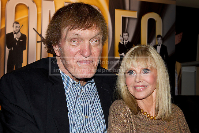 24/09/2012. LONDON, UK. Actress Britt Ekland, who played Bond Girl 'Goodnight' in 'The Man with the Golden Gun' and actor Richard Kiel, who played Bond villain 'Jaws' in 'The Spy Who Loved Me' and 'Moonraker' are seen inside HMV's Oxford Street store in London, today (24/09/12) during a photocall. The stars were in London during the final leg of a UK tour to promote the Bond 50 Blu-Ray collection.  Photo credit: Matt Cetti-Roberts