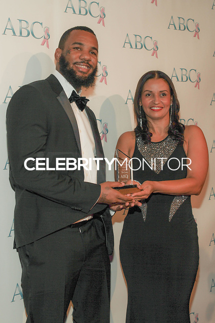 BEVERLY HILLS, CA, USA - NOVEMBER 22: The Game, Lisa Brunson arrive at the Associates For Breast And Prostate Cancer Studios 25th Annual Talk Of The Town Black Tie Gala held at The Beverly Hilton Hotel on November 22, 2014 in Beverly Hills, California, United States. (Photo by Rudy Torres/Celebrity Monitor)