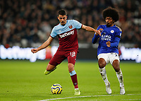 28th December 2019; London Stadium, London, England; English Premier League Football, West Ham United versus Leicester City; Ricardo Pereira of Leicester City challenges Pablo Fornals of West Ham United - Strictly Editorial Use Only. No use with unauthorized audio, video, data, fixture lists, club/league logos or 'live' services. Online in-match use limited to 120 images, no video emulation. No use in betting, games or single club/league/player publications