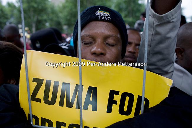 PIETERMARITZBURG, SOUTH AFRICA FEBRUARY 4: An unidentified ANC supporter prays early in the morning as he is waiting for ANC president Jacob Zuma to appear in court on February 4, 2009 in Pietermaritzburg, South Africa. Jacob Zuma appeared in court and a court date was set for August 2009. Mr. Zuma was recently cleared of charges and he is expected to win the general election on April 22, and become South Africa's third democratic president. (Photo by Per-Anders Pettersson)...
