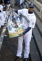 04 October 2009: Seattle Mariners designated hitter Ken Griffey Jr holds up a poster for the TV camera showing his famous winning run slide into home plate at the King dome during the game against Texas. Seattle won 4-3 over the Texas Rangers at Safeco Field in Seattle, Washington.