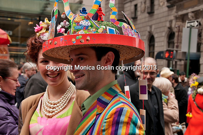 A man wears a hat made out of the Candy Land game for the Easter Day Parade in New York City on Fifth Avenue