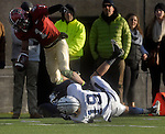 (Cambridge Ma 11/22/14) Harvard 1, Andrew Fischer,  gets by Yale 19, Morgan Roberts, for a touch down in the second half, Yale would come back to tie the game later in the half before Fischer last touch down late in the fourth quarter put the game away, as Harvard defeated Yale 31-24. Jim Michaud Photo