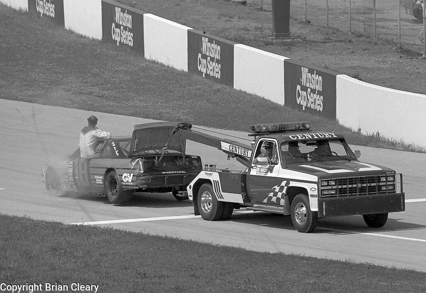 Ron Esau towed back to pits garage after crash accident Winston 500 at Talladega Superspeedway in Talladega , AL in May 1989.  (Photo by Brian Cleary/www.bcpix.com)