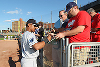 Lake County Captains outfielder Luigi Rodriguez #6 signs autographs prior to the game against the Dayton Dragons at Fifth Third Field on June 25, 2012 in Dayton, Ohio. Lake County defeated Dayton 8-3. (Brace Hemmelgarn/Four Seam Images)