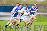 St Mary's Daniel Daly breaks through the challenges of Annascaul's Andrew Finn & Kenneth Quirke in the Con Keating Park in Cahersiveen on Sunday St Mary's 2-15 Annascaul 2-14.