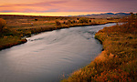 Montana, Missoula. The Clarkfork River winds through the rural landscape under  autumn twilght.
