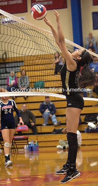 BERLIN CT. 16 November 2013-111613SV13-#29 Anna Khalid of Woodland High tips a ball over the net against Foran High during the CIAC Class M championship at Berlin High in Berlin Saturday. Woodland won 3-1.<br /> Steven Valenti Republican-American