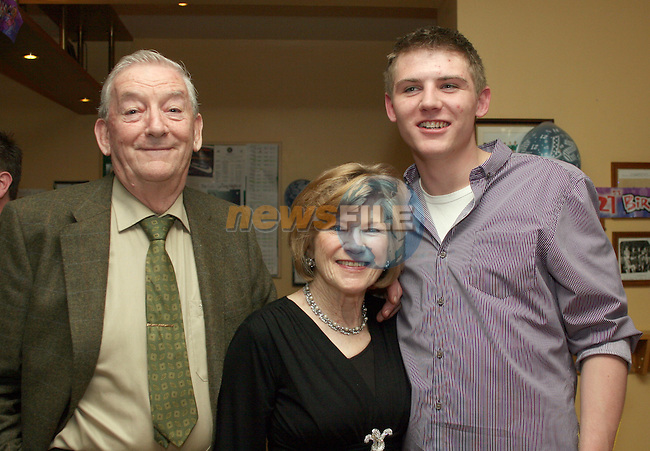 Barry Flanagan with his grandparent at his 21st O'Raghallaigh's...Photo NEWSFILE/Jenny Matthews.(Photo credit should read Jenny Matthews/NEWSFILE)....This Picture has been sent you under the condtions enclosed by:.Newsfile Ltd..The Studio,.Millmount Abbey,.Drogheda,.Co Meath..Ireland..Tel: +353(0)41-9871240.Fax: +353(0)41-9871260.GSM: +353(0)86-2500958.email: pictures@newsfile.ie.www.newsfile.ie.FTP: 193.120.102.198.