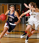 JANUARY 24, 2015 -- Tuileisu Anderson #32 of CSU-Pueblo drives past Taylor Trohkimoinen #11 of Black Hills State during their Rocky Mountain Athletic Conference women's basketball game at the Donald E. Young Center in Spearfish, S.D. Saturday. (Photo by Dick Carlson/Inertia)