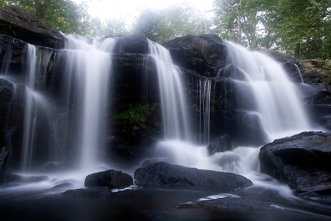 Time exposure creates the blur in the water at this large waterfall.