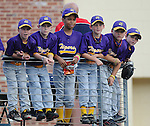 Several young ballplayers hang onto a railing, watching Greenville Drive players warming up prior to a game on May 20, 2010, at Fluor Field at the West End in Greenville, S.C.