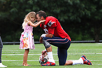 August 1, 2018: New England Patriots quarterback Tom Brady (12) shares a moment with his daughter Vivian Lake Brady at the New England Patriots training camp held on the practice fields at Gillette Stadium, in Foxborough, Massachusetts. Eric Canha/CSM