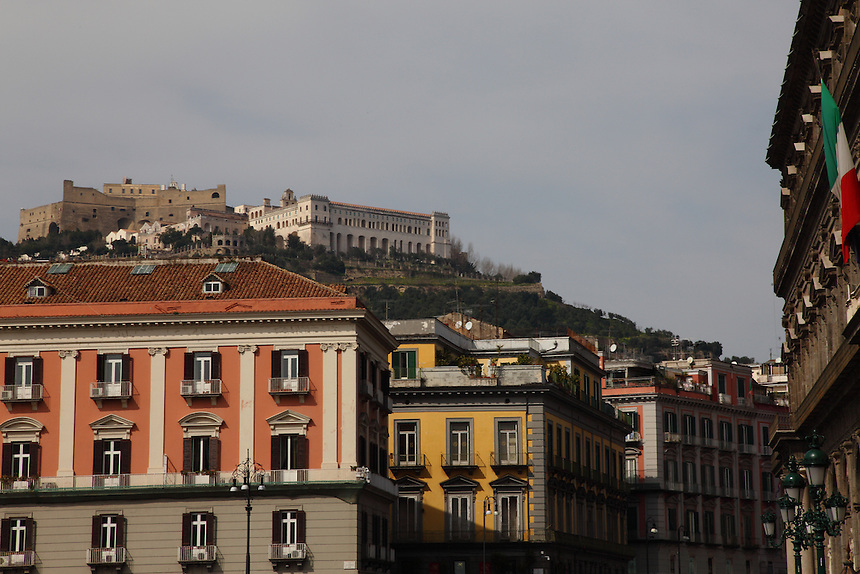 Napoli: A view of the Vomero hill, where is located the ancient Castel Sant&rsquo;Elmo, with the white buildings of the Certosa and of the San Martino museum in front. In foreground, there are some colorful buildings of a corner of piazza del Plebiscito (Plebiscite square), in the central south part of the town, near the sea. Among these last ones, there is the Napoli&rsquo;s prefecture and, on the right, one can distinguish a part of the ancient walls of the Real Palace.<br /> <br /> You can download this file for (E&amp;PU) only, but you can find in the collection the same one available instead for (Adv).