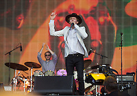 Beck Hansen (Beck) plays harmonica to end the set during British Summertime Music Festival at Hyde Park, London, England on 18 June 2015. Photo by Andy Rowland.