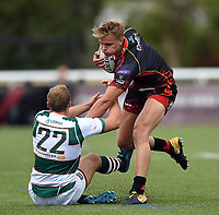 George Gasson of the Dragons fends Craig Willis of Ealing Trailfinders. Pre-season friendly match, between Ealing Trailfinders and the Dragons on August 11, 2018 at the Trailfinders Sports Ground in London, England. Photo by: Patrick Khachfe / Onside Images