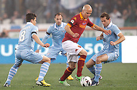 Calcio, Serie A: Roma vs Lazio. Roma, Stadio Olimpico, 8 aprile 2013..AS Roma midfielder Michael Bradley, of the United States, center, is challenged by Lazio midfielder Hernanes, of Brazil, left, and midfielder Senad Lulic, of Bosnia, during the Italian serie A football match between A.S. Roma  and Lazio at Rome's Olympic stadium, 8 april 2013..UPDATE IMAGES PRESS/Riccardo De Luca